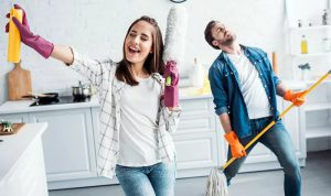 happy couple sprucing up their kitchen