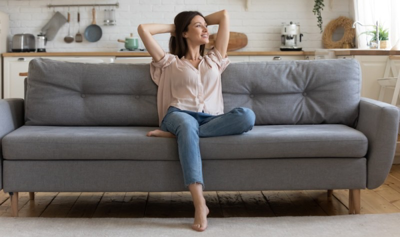 young woman sitting relaxed on a couch